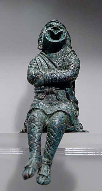 Tricky slave - Actor playing a slave and wearing a comic mask. Bronze statuette, early 3rd century AD.