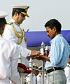 Adm Robin Dhowan posthumously awarding the Nao Sena Medal (Gallantry) to the late Vishnu P Unni.jpg