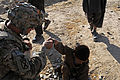 Afghan translator lends a helping hand to an Afghan boy DVIDS489692.jpg