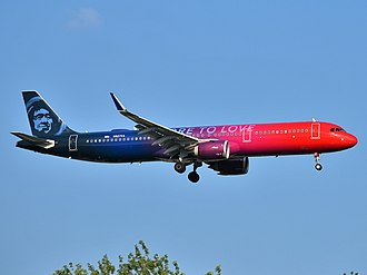 "To mark the acquisition of Virgin America, Alaska Airlines painted a few aircraft in special liveries. This Airbus A321neo, registered N927VA, wears a ""More to Love"" special livery. Alaska Airlines Airbus A321-253N N927VA approaching JFK Airport.jpg"