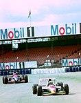 Alessandro Zanardi - Lotus 107 and Rubens Barrichello - Jordan 193 during practice for the 1993 British Grand Prix (33302883480).jpg