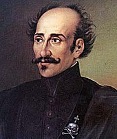 Portrait of a balding man with a handlebar mustache