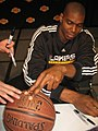Andrew Bynum signing autographs at Lakers Fan Jam.jpg