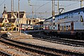 Ansicht vom Seedamm auf den Bahnhof in Rapperswil, zwei RABe's 514 der S-Bahn Linien S7 und S15 kurz vor der Abfahrt nach Zürich 2011-11-18 15-40-10.jpg