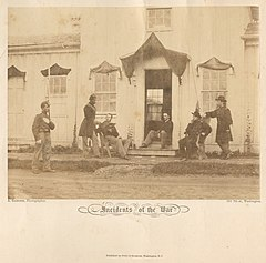 Arlington, Va. Capt. Nevins and officers in front of headquarters, Fort Whipple; mourning crepe drawn over doors and windows (7901780166).jpg