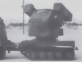 Avenger installed on rear articulated unit of M973 all terrain vehicle.png