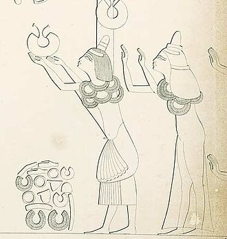 Tey - Ay and Tey as depicted in Amarna tomb 25. They are receiving gifts from Akhenaten and Nefertiti. (From Lepsius, Denkmäler)