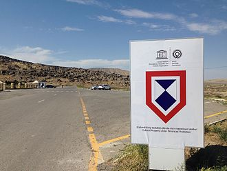 Hague Convention for the Protection of Cultural Property in the Event of Armed Conflict - The enhanced protection emblem displayed at the Gobustan Archaeological site in Azerbaijan.