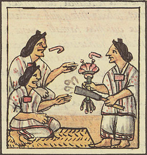 Aztec women are handed flowers and smoking tub...
