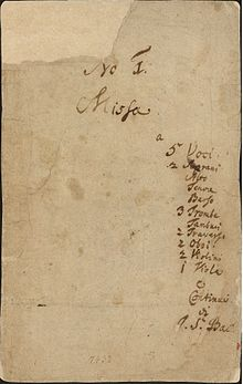 front page of the autograph of the first book, listing the title, the scoring and the abbreviated name of the composer on pale paper