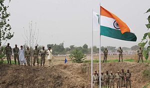 Simla Agreement - Pakistan Rangers are standing with the Flags of India and Pakistan