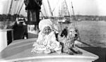 Baby and a dog on a sailing ship (7082739619).jpg