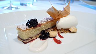 Bakewell tart - A version of the Bakewell tart with huckleberries, marcona almonds, and crème fraîche sherbet served at The French Laundry, California.