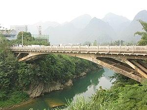 Longzhou County - Border bridge crossing between Shuikou Township of Longzhou and Ta Lung, Vietnam over the Shuikou River.