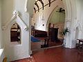 Berden St Nicholas interior - 12 chancel arch with open niches.jpg