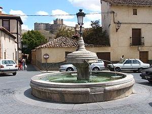 Berlanga de Duero - Fountain in Berlanga with Berlanga Castle in the background.