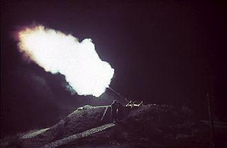 Bombing of Helsinki in World War II - Bofors anti-aircraft gun firing at enemy bombers. Taivaskallio, Helsinki. November 1942