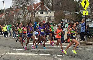 2015 Boston Marathon - Lead group of nine women at mile 19, with Caroline Rotich on left