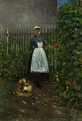 Girl with a basket of vegetables in a garden.