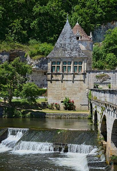 Tower of Saint-Roch and Renaissance detached house, near the river Dronne, Brantôme, Dordogne, France.