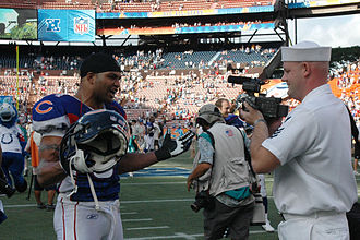 Brendon Ayanbadejo - Ayanbadejo talking with a sailor at the 2008 Pro Bowl.