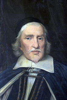 A painting of the head and shoulders of a robed white man with mid-length white hair and a Van Dyck.