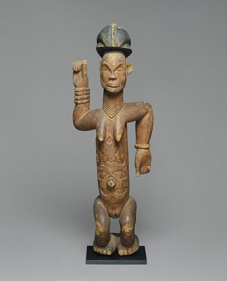 "Kongo cosmogram - From the collection of the Brooklyn Museum, this figure's arms and its diamond and cross insignia refer to the ""four moments of the sun""—dawn (birth), noon (life at its fullest), sunset (the end of life's journey), and, finally, for those who lead exemplary lives, a second dawn (rebirth)"