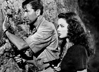 Bruce Cabot - Cabot and Gene Tierney in a scene from the film Sundown (1941).