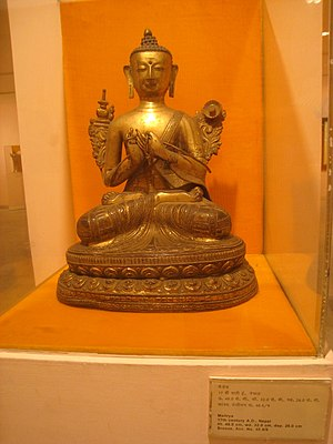 Sitting - An Indian Buddha, seated