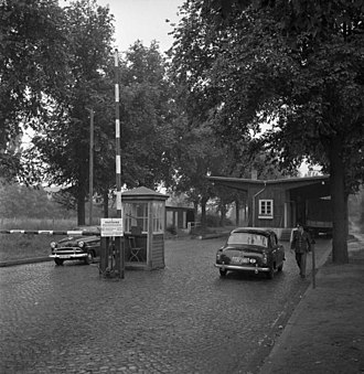Staaken - Heerstrasse border crossing in 1955, an Opel vehicle heading east to West Berlin and a Mercedes heading west into East Germany