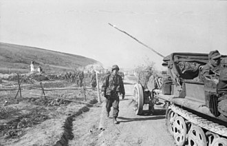 Operation Citadel - German half-track towing a gun during the operation