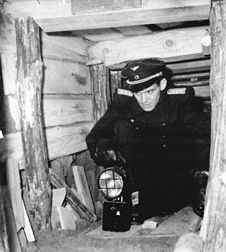 Republikflucht - Deutsche Reichsbahn official inspecting the escape tunnel beneath Berlin Wollankstraße station in January 1962.