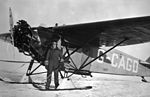 Bush pilot G.W. Grant McConachie standing next to airplane. (24601852431).jpg