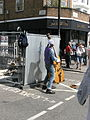 Busker at the junction of Talbot Road and Portobello Road, London W11.jpg