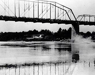 Buster Boyd Bridge - A biplane flies beneath the original Buster Boyd Bridge on August 17, 1923.