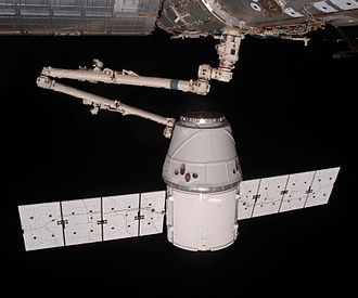 SpaceX Dragon - The CRS Dragon being berthed to the ISS by the Canadarm2 manipulator during the COTS 2 mission