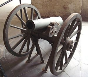 "Antoine Treuille de Beaulieu - Rifled mountain cannon ""Canon de montagne de 4 modèle 1859 Le Pétulant"". Caliber: 86 mm. Length: 0.82 m. Weight: 101 kg (208 kg with carriage). Ammunition: 4 kg shell."