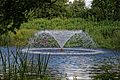 Capel Manor lake fountain from the north, Enfield London England.jpg