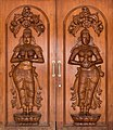 Carved double door with two wooden reliefs of standing women, Chinatown, Singapore.jpg