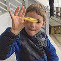 Child with spinner (34074347651).jpg