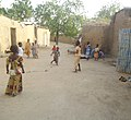Children in a village playing rope jumping.jpg