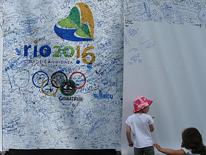 2016 Summer Olympics - A young girl adds her signature in support of Rio de Janeiro's candidacy.