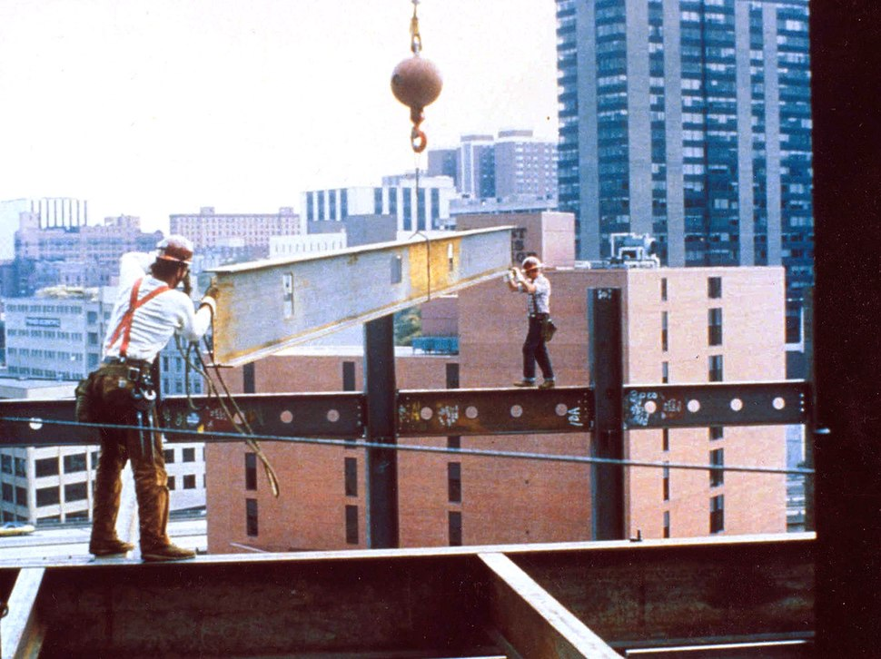 Construction workers not wearing fall protection equipment