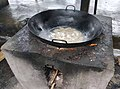 Cooking with a wok on an outdoor stove 2.jpg
