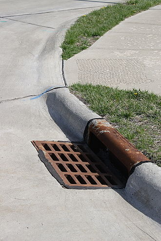 Grating - Curb, gutter, and grating covering a storm drain