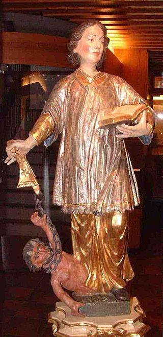 Den hellige Cyriacus driver ut demoner, statue i Altenheim St. Cyriak i Furtwangen
