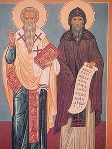 Icône représentant deux saints en toge, auréolés, portant barbe longue et tenant respectivement une bible ou un parchemin.