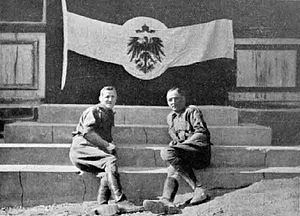 South West Africa campaign - South African officers pose with a captured German flag in Windhuk.