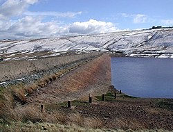 Picture of Deanhead Reservoir with snow on the surrounding hills