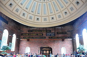 Quincy Market - Dome Inside the Market building, 2010. This serves as the seating area for the food court now. The sign boards of old businesses decorate the walls
